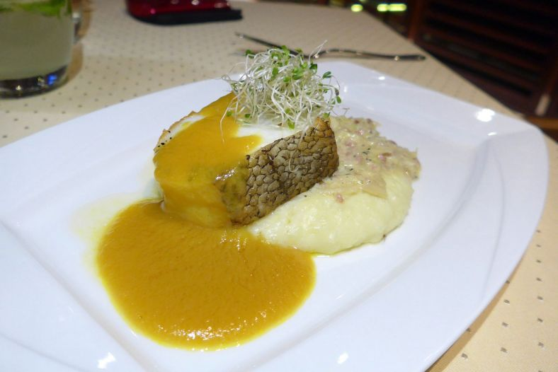 Pan-Seared Cod Fish with White Cabbage and Yellow Paprika Sauce
