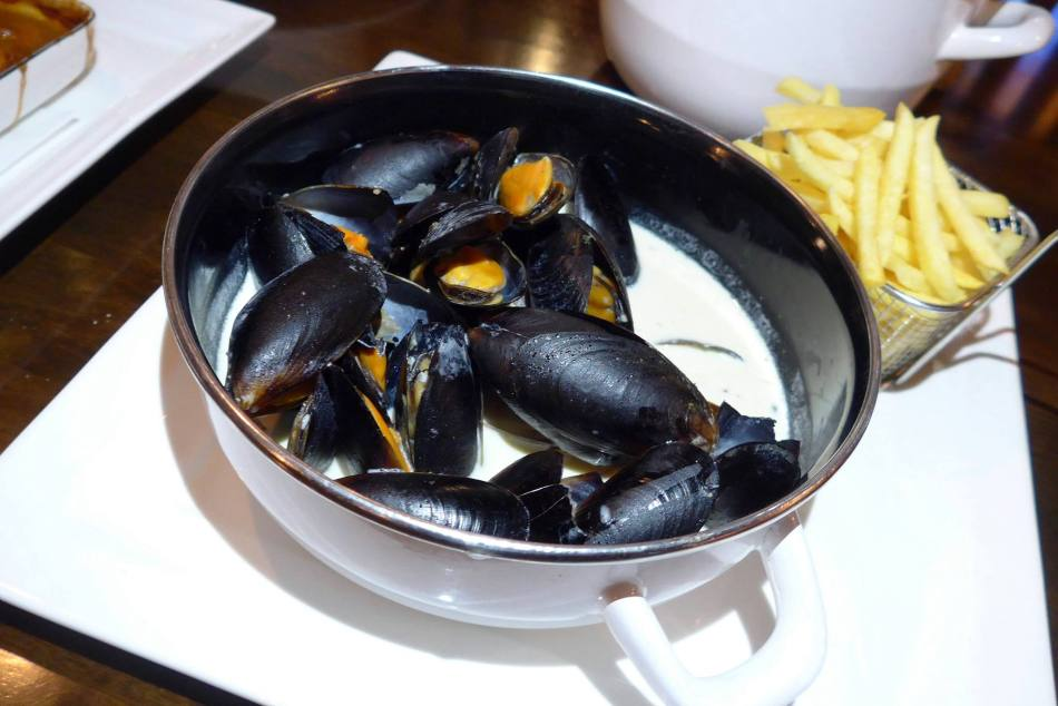 Mussels served with creamy white wine sauce and french fries - RM42.00
