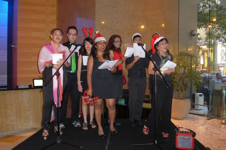 Carollers serenading the guests with Christmas carols