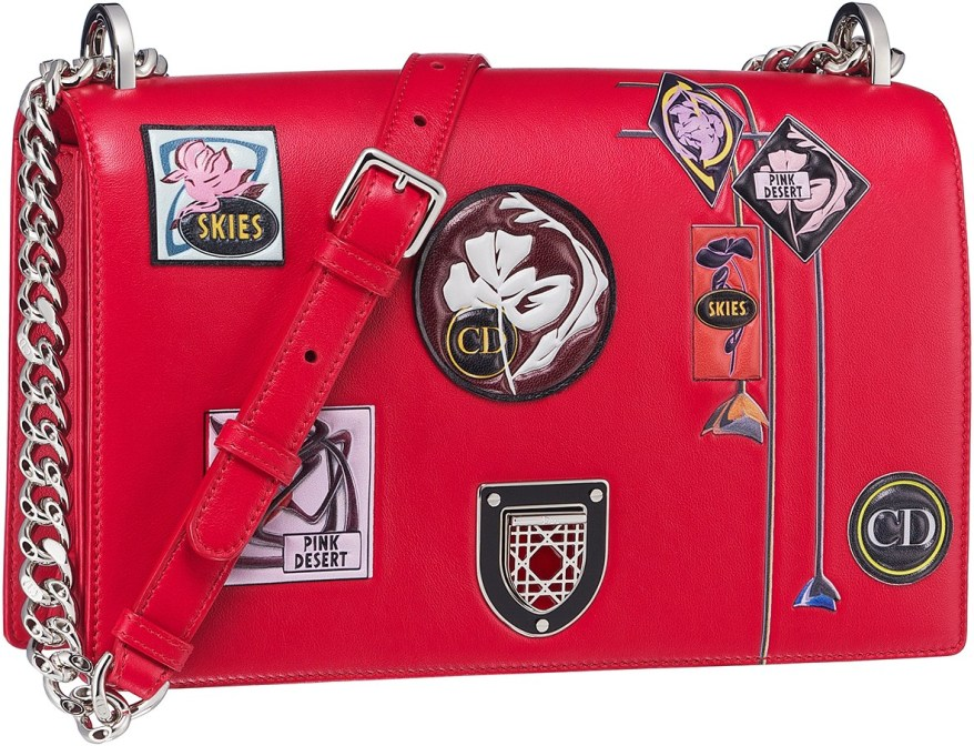 Diorama bag in red paradise calfskin, badges and flowers in embossed leather, enamel framed badge closure