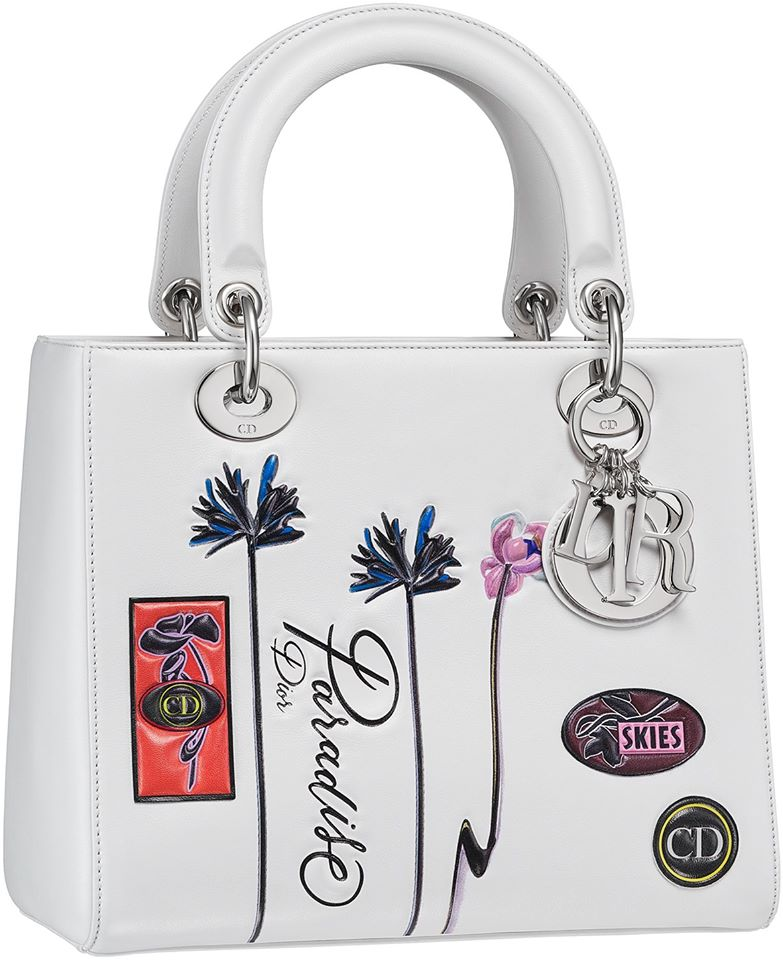 Lady Dior bag in white paradise calfskin, badges and flowers in embossed leather, large strap
