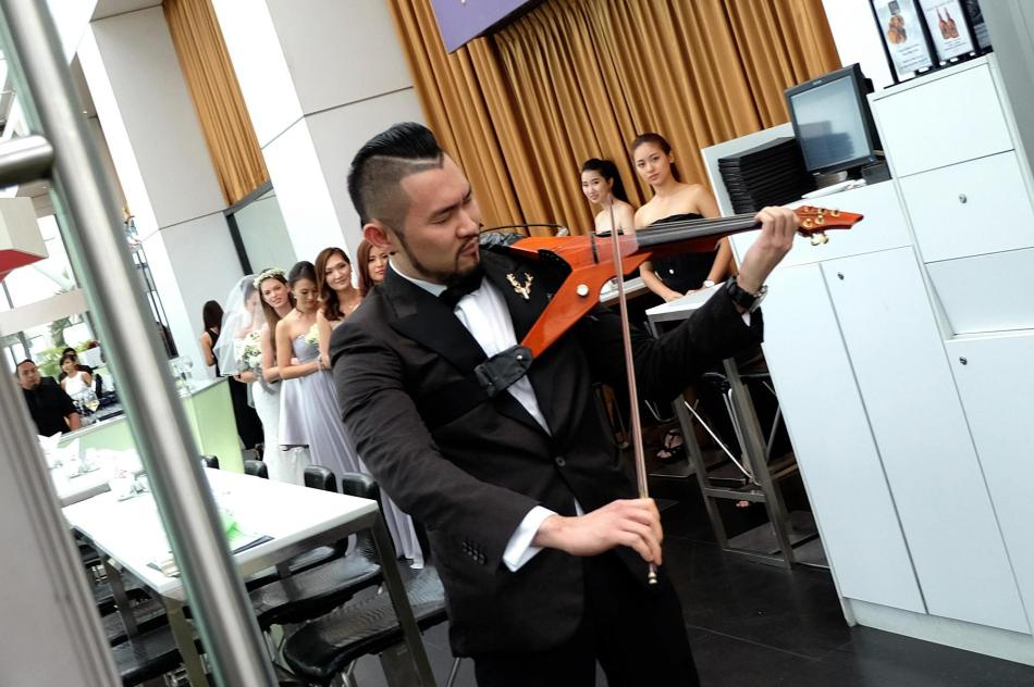 Violinist Dennis Lau provided the tunes for the wedding march