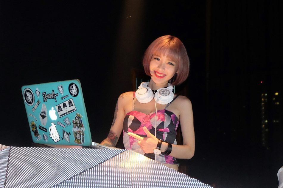 The cute DJ Queena on the decks at Ruyi & Lyn's NYE countdown party
