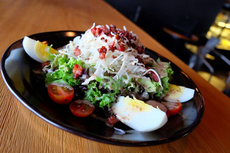 Anytime Salad - RM12.00- mixed green salad + hard boiled egg + bacon chips with roast sesame dressing