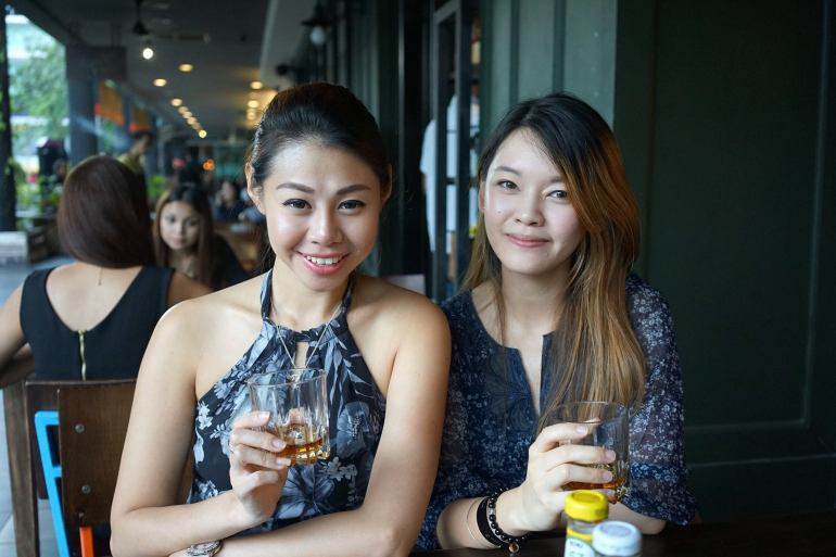 Evonne and Anna chilling over some drinks before the event starts