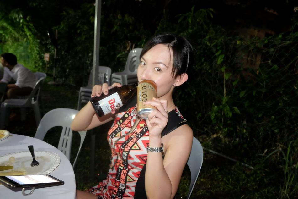 Elaine (no she's not my partner in crime) enjoying the drinks from all the different countries