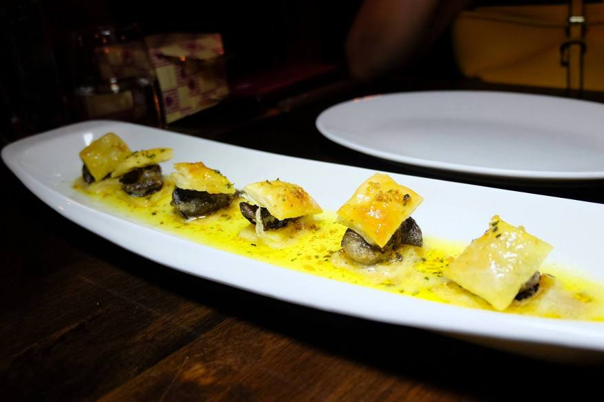"""Escargots"" snails with parsley and garlic butter sauce in vol au vent - RM34.00"
