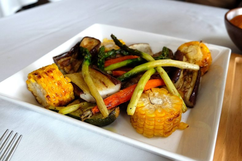 The sides which includes roasted spring vegetables like corn and asparagus