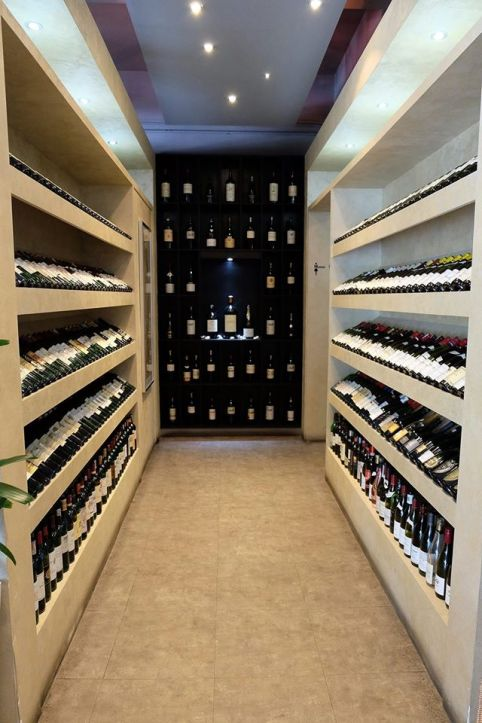 Walkway to the washroom featuring empty wine bottles (no this is NOT the wine cellar)