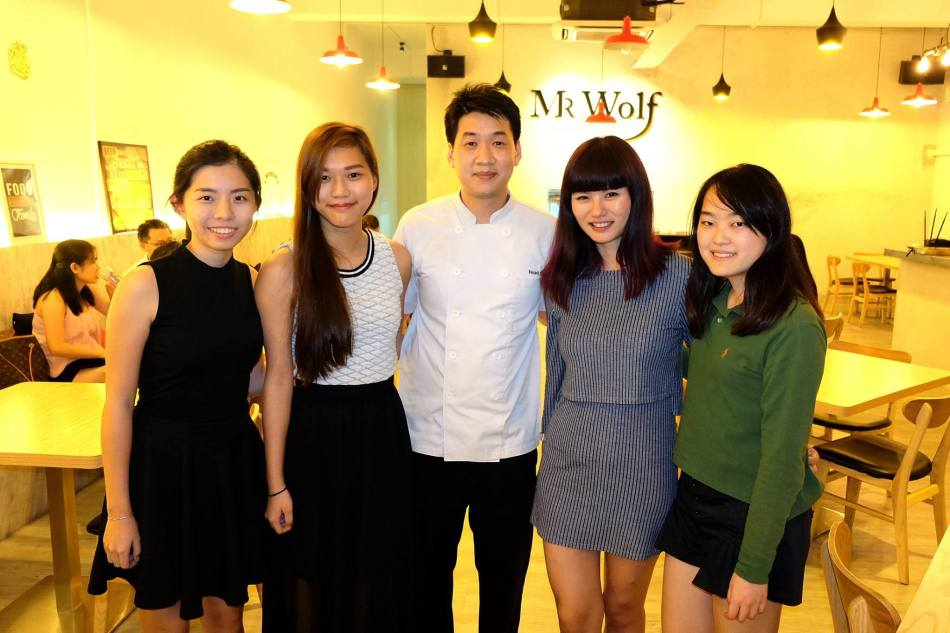 The girls with the chef and owner of Mr. Wolf