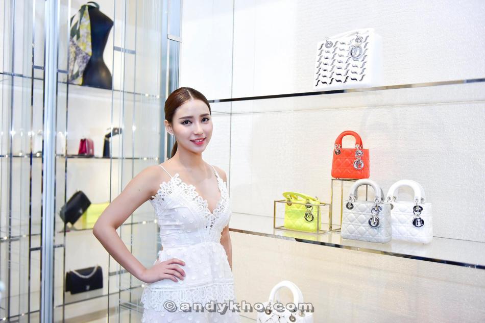 Venice Min admiring the Dior bags