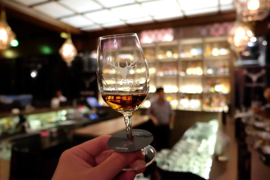 """Checking the """"tears"""" of the whisky as well as its colour"""