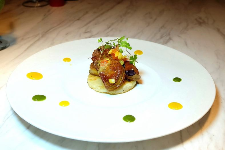 Foie Gras - Pan seared Goose Liver served on a Pineapple slice drizzled with Madagascan Vanilla Pod Infused Honey - RM45