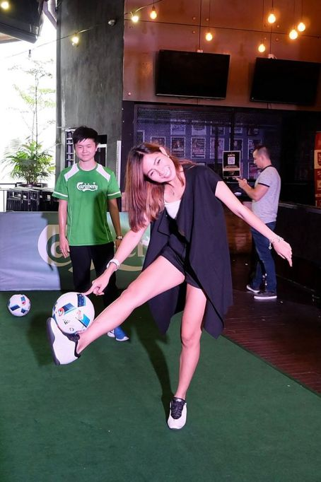 Dancer Cecilia Yong trying out her footie skills