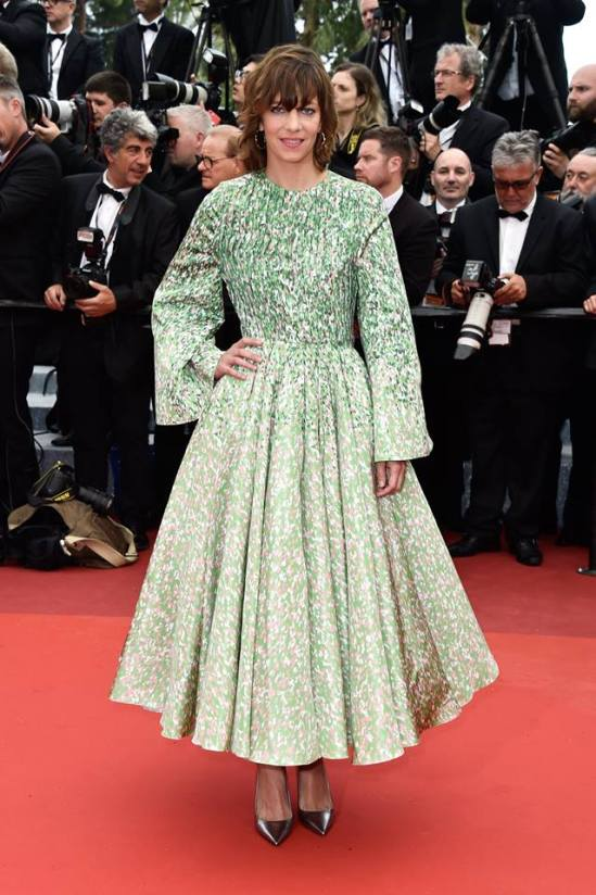 Celine Sallette wore a printed Green, white and black silk faille coat Dior Haute Couture, Bois de Rose earrings by Dior Fine Jewelry