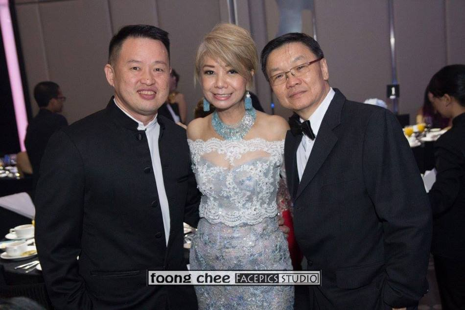 Datin Winnie Loo with Dato Raymond Liew of McMillan Woods and friend