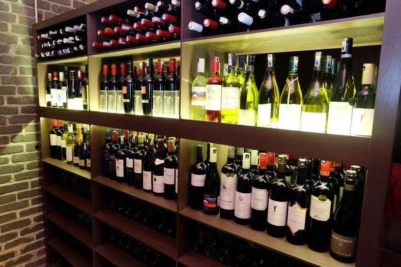 The wine racks which offer a selection of reds, whites, sparklings and champagnes