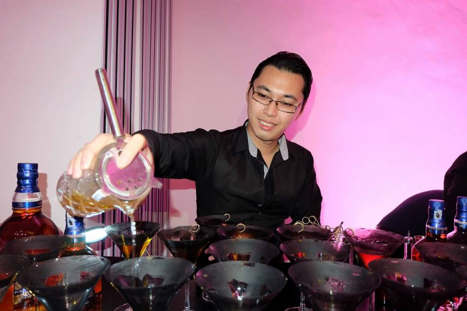 One of Malaysia's top mixologists Kelvin Lee making a Chivas 18 cocktail for us