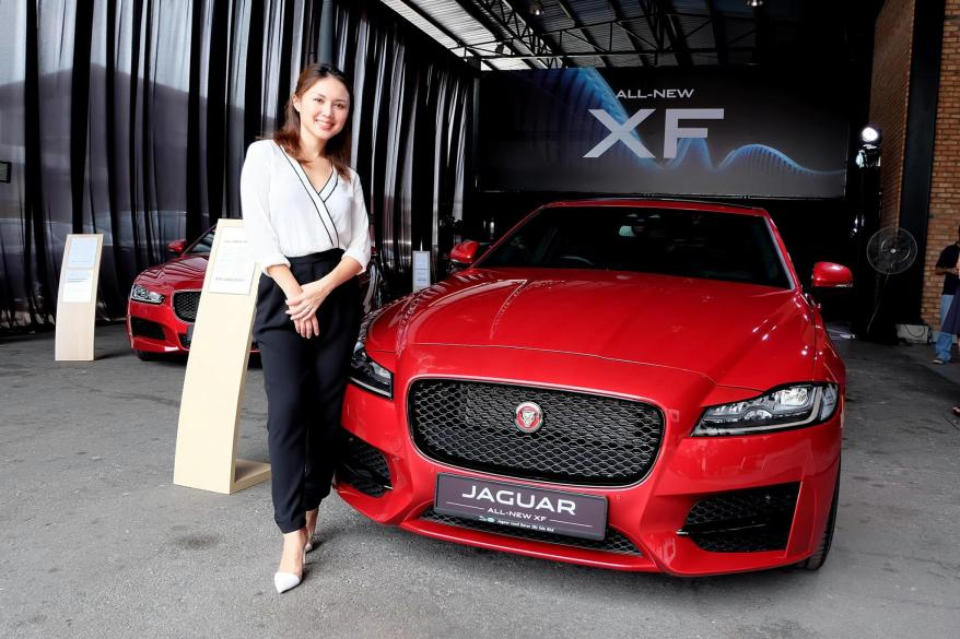 MC of the event, Julie Woon with the new Jaguar XF