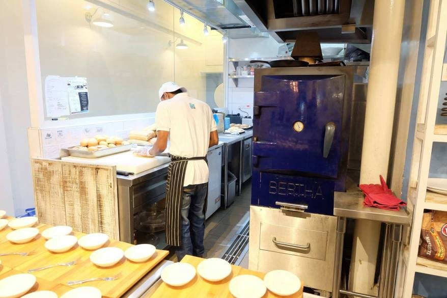 The open kitchen contains a Bertha oven