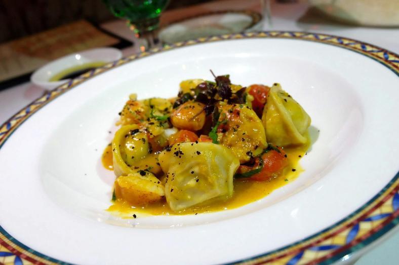 Tortelloni di finferli Chanterelle tortellini with pumpkins cream, confit half lobster and sauté artichoke - RM170.00