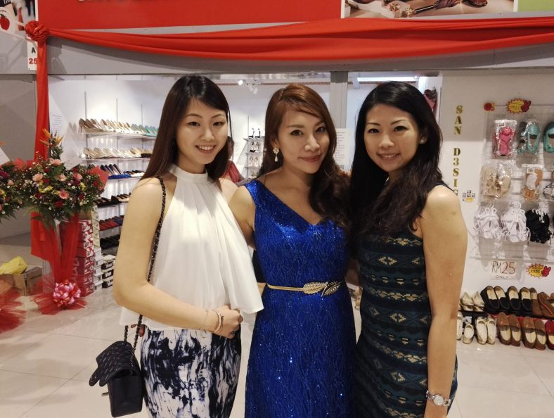 Lin Lin, Sarah and Grace using the rear camera in rather dim lighting