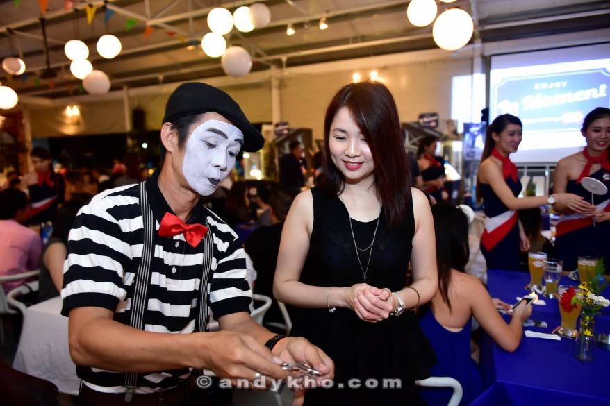 A magician entertaining Kassey with his tricks