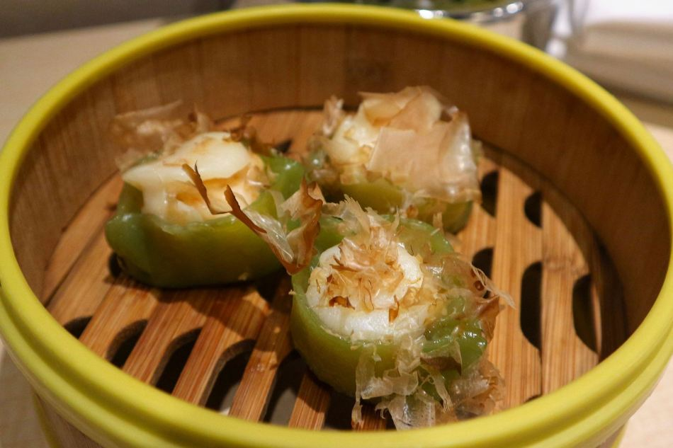 Emerald dumpling topped with fresh scallop - her favourite dish!