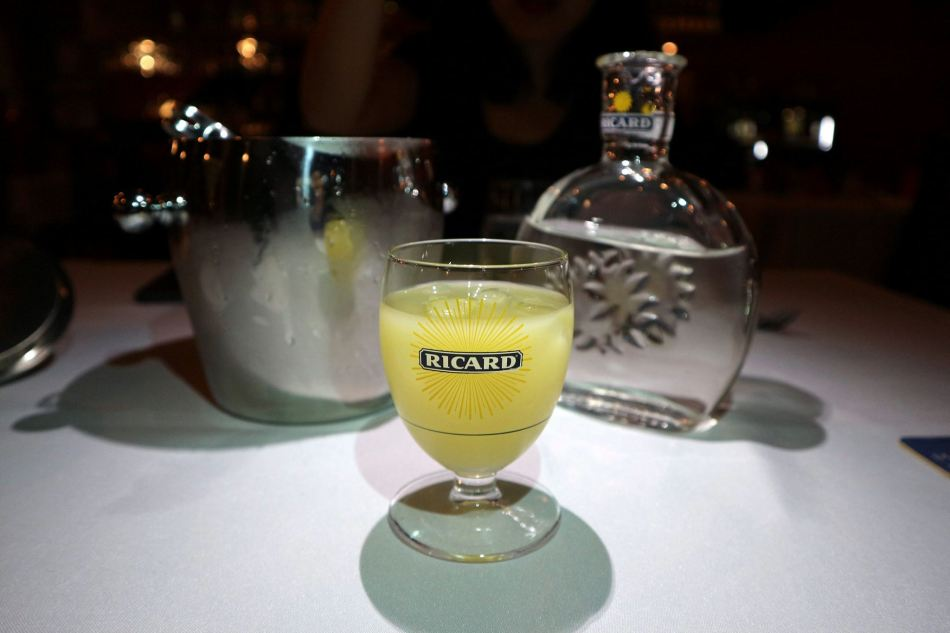 The Pernod which is mixed with some water resulting in a pretty refreshing drink. Great to work up an appetite.