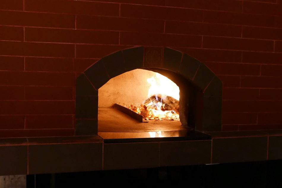 The interior of the restaurant wasn't changed much except the addition of a wood fire oven which is primarily for baking the pizzas