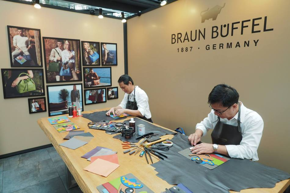 Demonstration by two of the house's artisans who handcrafted the intricate leather embellished details of Buffy & Bully, the brand's whimsical representation of the buffalo icon
