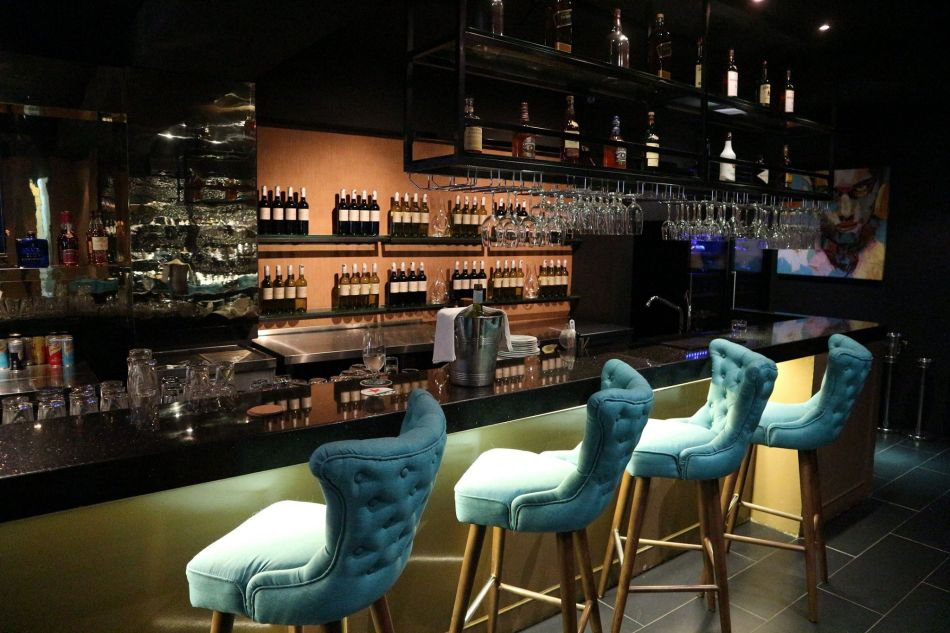 The fully stocked bar which offers everything from beers to liquor and of course wines