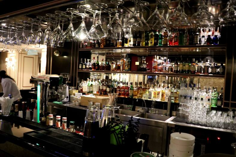 The well stocked bar which serves everything from cocktails to liquor and wines