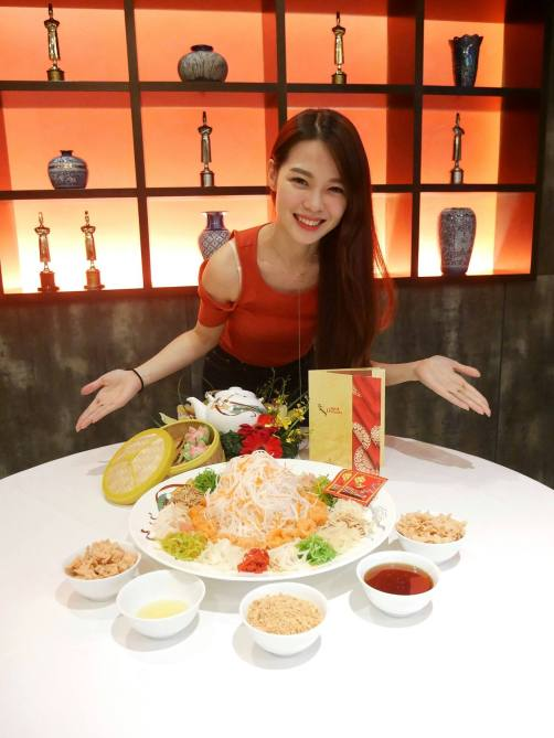 Joyce with the yee sang during the CNY review at Dynasty Chinese Restaurant at Renaissance Kuala Lumpur Hotel