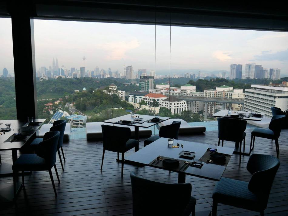 """The """"balcony"""" dining area which is air conditioned and has a lovely view of the KL skyline"""