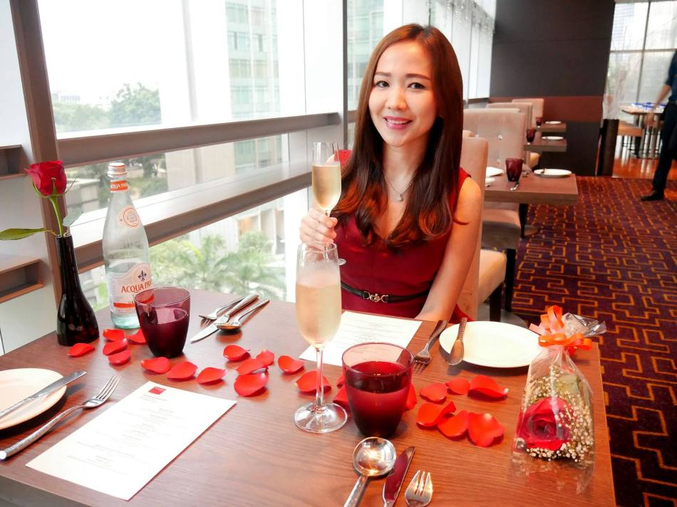 The table was decorated with rose petals while there was a flower for her