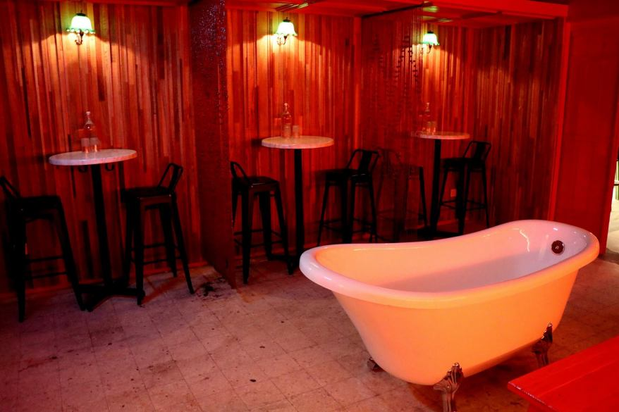 The bathtub is for nights when you feel like ordering a dozen bottles of bubbly