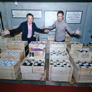 Andrew (left) and friend in the cellar with the premium wines