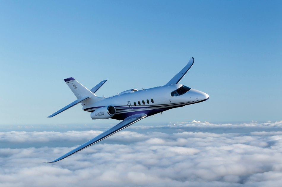 Cessna Citation Latitude flying in the sky above clouds