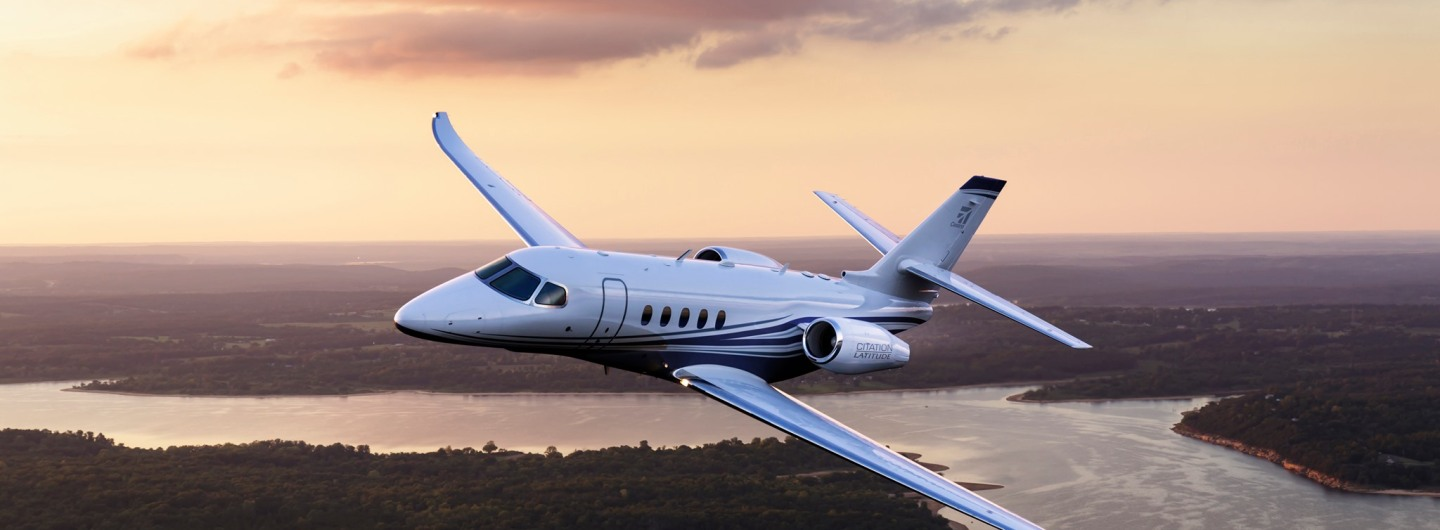Cessna Citation Latitude flying over a river