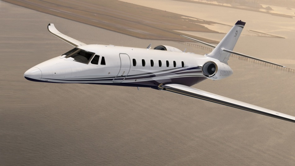 Cessna Citation Sovereign+ flying above the sea
