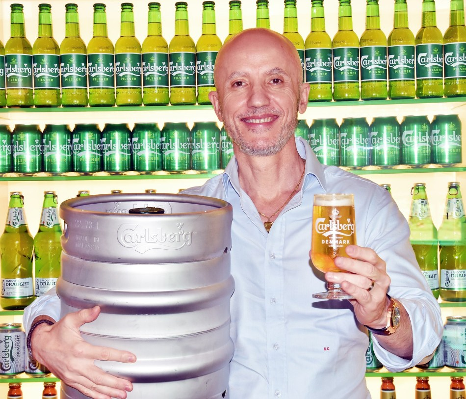 Stefano Clini, Managing Director of Carlsberg Malaysia with a beer keg adopt a beer 2020